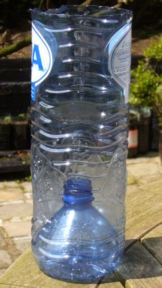 use the top of the bottle as a drain for the plastic bottle planter