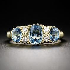 Antique Aquamarine and Diamond ring, Lang Antiques  Designed and rendered in the classic Victorian style, but utilizing unconventional center stones-- in this case three lucent, deep pastel blue aquamarines-- this extra-lovely and eminently wearable jewel was crafted in Great Britain in rich 18K yellow gold and is currently ring size 7 1/4 +.