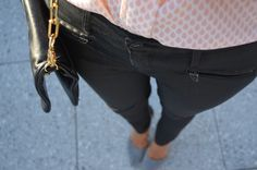 coated jeans with zippers and pointy pumps