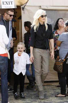 Gwen Stefani. Dramatic top, simple trousers, booties. She is so cool!