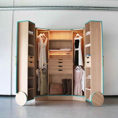 Contemporary dressing room with hosun ching walk in closet wheels, and ikea free standing closets. Creative light brown closet wooden drawers, and walk in closet organizers using wooden