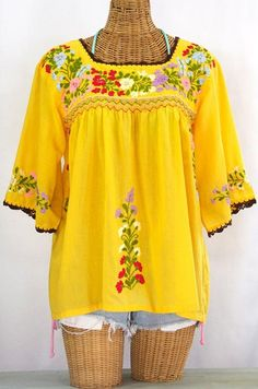 """Siren's """"La Marina"""" Embroidered Mexican Blouse in Goldenrod with crochet trim, $52.95."""