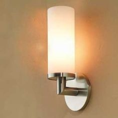 Ginger Kubic Single Bathroom Light by Ginger. $265.20. Size:Large Rosette, Finish:Satin Nickel (Brushed Nickel), Light Bulb:(1)100w A19 Med F Incand With its round rosettes and shallow drill points, the Kubic collection has both industrial-strength function and hi-tech design.The Kubic  Vanity Light, with a mouthblown, satin-etched Opal shade.    May be installed with shade facing upwards or downwards.  Note: The backplate of the small rosette version is not of standard ...