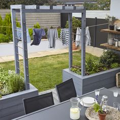 Does your garden have a colour scheme? Get inspired with this grey trellis and decking. And grab yourself a furniture set to match.