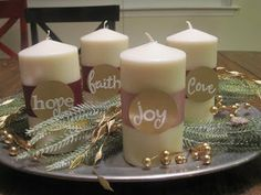 """Plumberry Pie: Updated Advent """"Wreath"""" I might like this without the words and just the purple and pink ribbon on white candles Christmas Advent Wreath, Christmas Love, Christmas Countdown, All Things Christmas, Christmas Holidays, Christmas Decorations, Advent Wreaths, Christmas Tables, Christmas Nativity"""