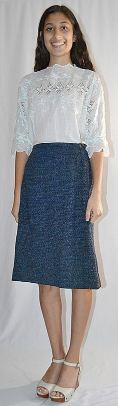 A vintage 1950s blue wool tweed pencil skirt with a nice back pleat and embroidery detail. The skirt was made by Loubella Originals,
