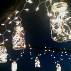 Mason jars and white lights for a wedding arbor.