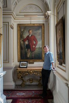 The Duke of Northumberland with a portrait of his father, the 10th duke, at Alnwick Castle