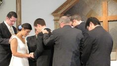 Elders praying over the new couple: dig that idea.. have never seen it before, but like it alot!
