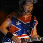 ~ That Was NO Apology! This Uber Idiot Is A Disgrace! -- Ted Nugent Defiantly Gives Non-Apology For Calling President Obama A 'Subhuman Mongrel' News Hour, Mongrel, Poster Boys, Concert Stage, Playing Guitar, Rock N Roll, Album Covers, My Music, Black Men