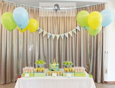 Evan just celebrated his first birthday. And his dad gave us the theme of Ice Cream and Candy to create his first dessert table!   We decided to go with a cheerful color scheme of blue, yellow and green.   And we definitely had lots of fun creating this dessert table. After all, who doesn't love ice cream and candy?