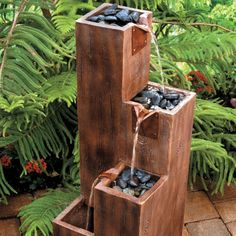 """Timber Wood Cascade Fountain Timber Wood Cascade Fountain, River Stones, Pump, Instructions Timber Wood Cascade Fountain Dimensions:Overall: 12""""Sq. x 34-1/4""""H Weight:24 lbs. Materials:Resin Assembly:Simple Assembly Required Electrical Requirements:Pump is UL Listed for Outdoors  $250"""