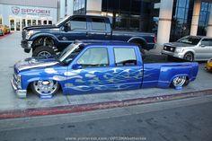 Slammed Chevy crew cab at #SEMA 2012 #flames