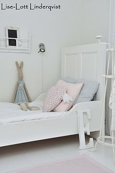 lovely Swedish/Danish white decor with Maileg bunny on the pretty bed