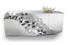 STELLAR cabinet by Jake Phipps - part of a collection of furniture in faceted, polished stainless steel.