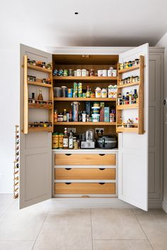 This gorgeous bespoke larder in London features oak interior drawers with cut-out handles, spice spices and a cold shelf to match the kitchen worktops, creating continuity and plenty of storage space! Kitchen Pantry Design, Kitchen Units, Open Plan Kitchen, Kitchen Shelves, New Kitchen, Kitchen Storage, Kitchen Cabinets, Kitchen Worktops, Oak Shelves