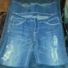 Like new Cute distressed jeans Like new cute distressed jeans. With studded back pockets. And flare legs Jeans Flare & Wide Leg