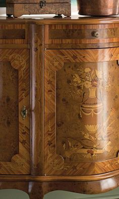 beautiful details of hand-crafted Louis XV style credenza inlaid with inlaid floral design: