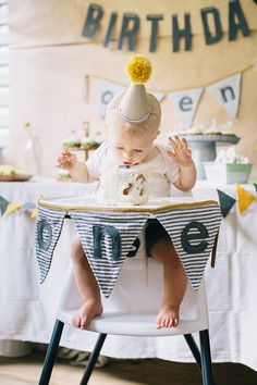 Simple, modern first birthday for Owen: felt + striped fabric sewn banners for highchair and dessert table | 100 Layer Cakelet