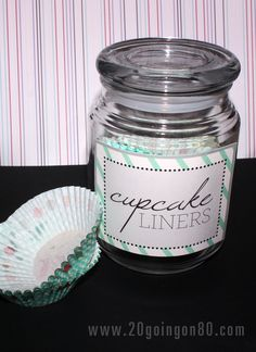 Use used up candle jars for kitchen organization... oh oh oh I will be making this this week! I have a million cupcake liners, and a countainer to put them in.  yay!