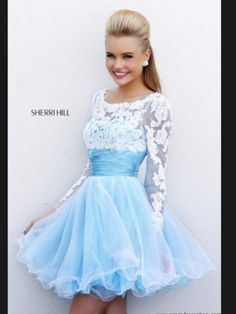 Pretty light blue prom dress with a white Lacey top to it