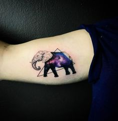 Vibrant Galaxy within Elephant. You might have seen a  number of animals incorporated into the galaxy tattoos like fox, unicorns etc. but you haven't seen this giant elephant in any galaxy tattoo yet. Well, that is the reason we have got this unique tattoo on the list.