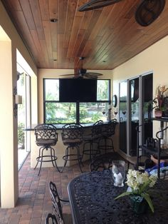 Traditional Porch with Wrap around porch, Stained Tongue and Groove Wood Ceiling, Screened porch, exterior brick floors