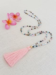 Long glass bead tassel necklace with a pink by Brightnewpenny