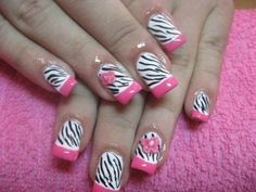 Cute zebra print nails with a PINK flower...