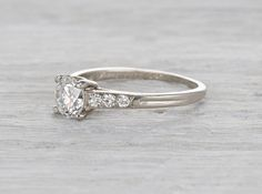 Retro palladium Tiffany & Co. engagement ring with a .72 carat GIA certified transitional cut diamond with G color and VVS1 clarity.