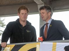 9/11/14.   Spectator: Prince Harry watches on from the stands with the Crown Prince of Denmark at the Lee Valley Athletics Centre