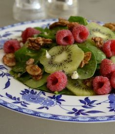 Spinach, Kiwi and Raspberry Salad with orange poppy seed dressing....oh I can't wait for these to be in season!