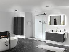 Inspirerende trends: warme houtsoorten zoals zwarte eik, dampwerende spiegels. Ook frames doen hun intrede, in combinatie met meubelen en inloopdouches. Zwart kraanwerk en accessoires zorgen voor de finishing touch! Exclusief verdeeld door X2O. #Balmani #X2O #frames #zwart kraanwerk #zwarte eik Design Moderne, Bathroom Inspiration, Bathroom Lighting, Bathtub, Mirror, Admiration, Furniture, Home Decor, Bathrooms