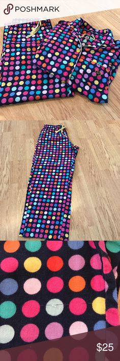 Victoria's Secret navy blue polka dotted pajamas m 100 percent cotton button up pajamas. Navy blue with quarter sized multicolored dots. Perfect for spring. Large yellow buttons. Single Pocket on breast. Pants have a small snag seen in pics. Size medium Victoria's Secret Intimates & Sleepwear Pajamas