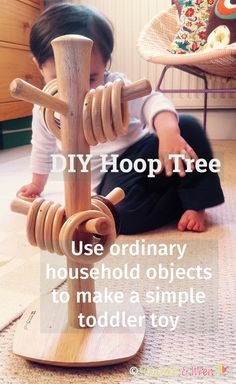 DIY Hoop Tree for babies and toddlers out of a mug stand and wooden curtain rings.
