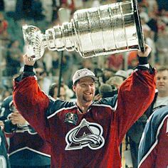 Patrick Roy, legendary Colorado Avalanche goalie, hoisting the Stanley Cup. The Avalanche would later return to Denver to celebrate their Cup win.