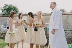 Bridesmaids arrive at the quaint village church in Dorset - reportage wedding photography by Dorset wedding photographer