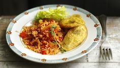 Jollof rice with fried plantains...Ghana memories! Serve with a side of grasscutter :)