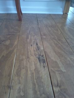 Great post on how to DIY wood floors. Seal sub-floor, cut plywood into strips, sand with 100 grit paper, stain, 3 coats polyurethane, dry-fit, install with glue and finishing nails with nickel as spacers, 1 more coat of polyurethane and its done! Under $1/square foot.