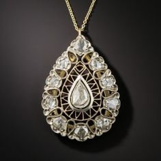 Measuring 1 1/2 high by just over 1 inch wide, this exotic and impressive vintage pendant, very likely by way of early-to-mid-20th century Iran, sparkles in the center and all around with over 2 carats of multi-shaped rose-cut diamonds set in silver accented with rose gold filigree. A stunning and majestic jewel.