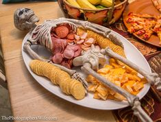 Skeleton meat, cheese, and crackers tray