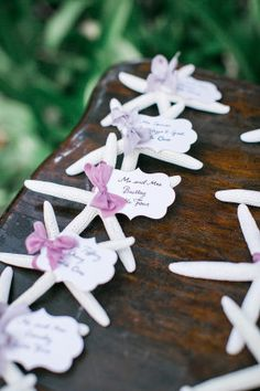 Starfish place cards were unique and perfectly beachy-chic at this outdoor wedding, which was surrounded by a stunning ocean backdrop. Wedding Favors For Guests, Hawaii Wedding, Purple Wedding, Maui, Wedding Planner, Special Occasion, Backdrops, Place Cards, Reception