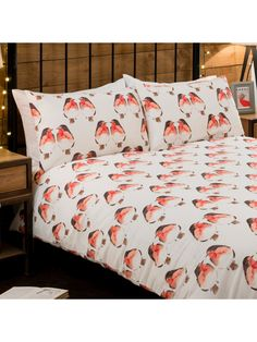 The Robin Print Duvet Set adds a festive touch to your room. With warm red accent on a cream ground and a matching printed reverse making it a key seasonal l...
