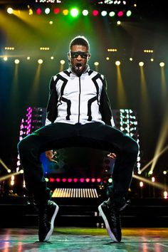 Watch Usher dance in concert. Check this one off. My bf took me in high school. Amazing!