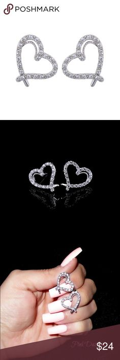 CZ Heart Stud Earrings Color: Silver Material: Cubic Zirconia, White Gold Plated over Stainless Steel Size: Approx. 2cm x 1.5cm Lead & Nickel Free Jewelry Earrings