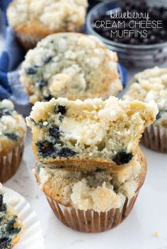Easy Blueberry Cream Cheese Muffins - the perfect blueberry muffin recipe filled with cream cheese and topped with streusel! The best breakfast recipe!
