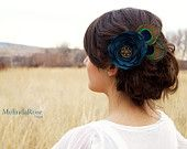 cute up-do with peacock feathers
