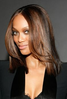 Tyra Banks, subtle makeup, shiny hair. This young lady has came a long way. From teen queen fashionista to Queen bee fashion diva in the runway and modeling world. :D