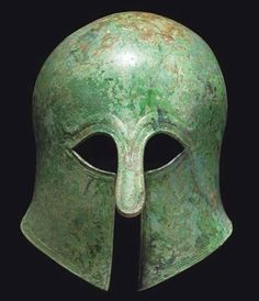 Corinthian helmet, mid 6th century B.C.Of domed form with protruding nose-guard and moulded eyebrows, a ridged band around the perimeter, 26 cm high. Private collection, from Christie's auction