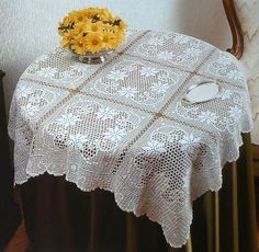 Filet crochet table cloth with pattern chart